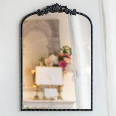 Elegant Black Mirror With Ornate Detail