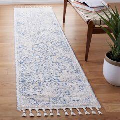 Ivory/Blue Tasseled Pattern Area Rug
